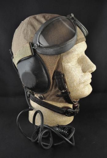 4f92f8c87f2 A model LKp S 101 Summer pilots flight helmet (left) complete with all  electronics and displayed with period. Luftwaffe flight goggles.